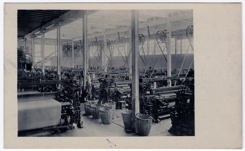 """""""The weaving room of a large woolen mill, showing looms. The process of making blankets"""""""